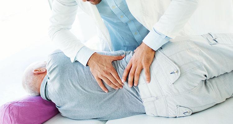 Distensão muscular lombar: Diagnóstico e sintomas